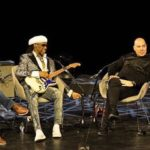 "Nile Rodgers demonstrates his writing process with his famous ""hitmaker"" stratocaster during a live Sodajerker podcast at Meltdown"